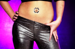 Woman with tattoo around navel Stock Photos