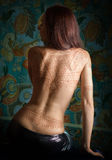 Woman with tattoo. Beautiful woman with tattoo on her back stock photo