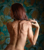 Woman with tattoo. Beautiful woman with tattoo on her back royalty free stock image