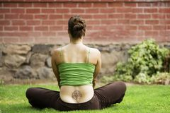 Woman with a Tattoo on Her Back stock images