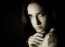 Woman with a tattoo on her shoulder Stock Photos