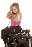 Woman tattoo motorcycle sit backwards look down Stock Photos