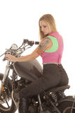 Woman tattoo motorcycle sit look down Royalty Free Stock Photography