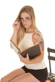 Woman Tattoo Sit Black Book Look Over Glasses Royalty Free Stock Photos