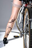 Woman with Tattooed Legs on a Bike Stock Photo