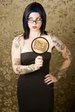 Woman with tattoos. Pretty young woman with many tattoos stock photography