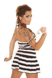 Woman tattoos back handcuffs prison. A woman with a tattoo and handcuffs in her hands royalty free stock photos