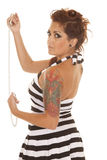 Woman tattoos back handcuffs serious. A woman in handcuffs with tattoos showing back royalty free stock images