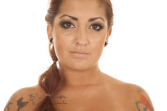 Woman tattoos close head straight Stock Photography
