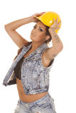 Woman tattoos construction hat on Royalty Free Stock Image