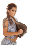 Woman tattoos cowgirl side hold hat smile Royalty Free Stock Photos