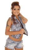 Woman tattoos denim vest arm on neck Royalty Free Stock Photo