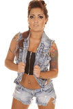 Woman tattoos denim vest facing Royalty Free Stock Images