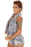 Woman tattoos denim vest side serious Stock Image