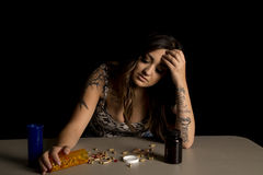 Woman with tattoos with drugs addicted Royalty Free Stock Images