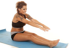 Woman tattoos fitness sit stretch Royalty Free Stock Photo