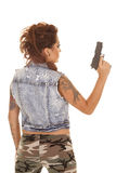 Woman tattoos gun back hold up Royalty Free Stock Photos