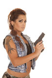 Woman tattoos gun looking serious side Stock Photography