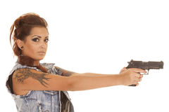 Woman tattoos gun point side looking Royalty Free Stock Images