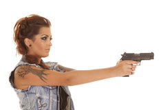 Woman tattoos gun point side Stock Photos