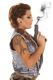 Woman tattoos gun profile blow Stock Image