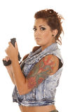 Woman tattoos gun side look Royalty Free Stock Photography