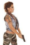 Woman tattoos gun side point down Royalty Free Stock Photos
