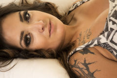 Woman with tattoos laying head close Stock Image