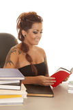 Woman tattoos red book look down Royalty Free Stock Photo