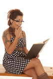 Woman tattoos shock read book Royalty Free Stock Image