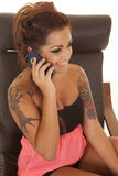 Woman tattoos talk on phone happy Stock Images