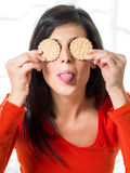 Woman taunting diet with crackers Royalty Free Stock Photos