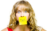 Woman with tax note over mouth Royalty Free Stock Image