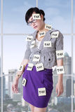 Woman with tax reminders Stock Photo