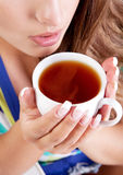 Woman with tea royalty free stock photography