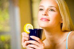Woman with tea Stock Images