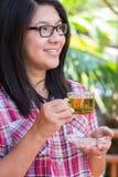 Woman and tea Stock Image