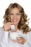 Woman with tea bag and cup in hand Royalty Free Stock Photo