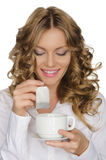 Woman with tea bag looks into cup Stock Photos