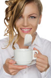 Woman with tea bag in your mouth and cup Royalty Free Stock Images