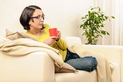 Woman tea coffee blowing in cup Royalty Free Stock Photography