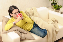 Woman tea coffee hot beverages relaxing ill Stock Photos