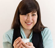 Woman with tea cup Stock Photos