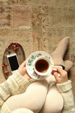 Woman with tea cup in hands, top view Royalty Free Stock Photo
