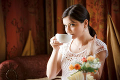 Woman with a tea mug in cafe Stock Image