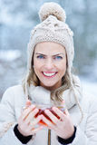 Woman with tea outdoors in winter Royalty Free Stock Photography