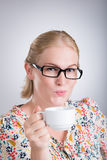 Woman with tea Stock Image