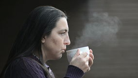 Woman with tea stock video footage