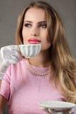 Woman with tea retro style portrait Stock Image