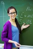 Woman  teacher background the school board Royalty Free Stock Photos